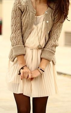 Knit cardigan sweater paired with a cinched-waist, above-the-knee, cream/ivory pleated dress