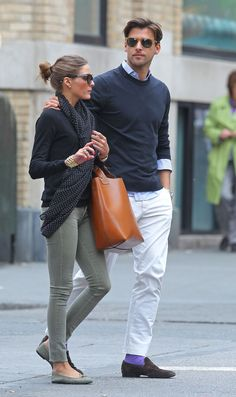 Olivia Palermo.  Love her outfit... Hunky guy ain't too shabby either.