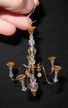 how to: chandelier - Went into my beads and found some silver bead spacers just like these! Awesome!                                                                                                                                                     More