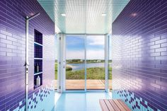 A brightly tiled bathroom in a waterfront home in New York