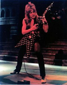 Randy Rhoads polka dot flying V. Bought from crazy luthier in Midwest. Not exactly Karl Sandoval quality, but keeps the flame of childhood hero going.