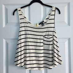 Striped tank with zippered back - cream/black Slightly cropped - super fun neon yellow zipper  in the back - 80% rayon/20% polyester. Forever 21 Tops Tank Tops