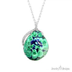Nature is the artist of this gem specimen Malachite Azurite necklace fabricated by hand from white gold and diamonds by our jewelry designers.