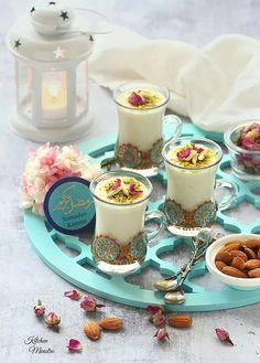 """Keshk El Omara or """"Almatheyet el Loz"""" a famous Ramadani cold dessert that is popular in the Levant region especially in Syria. Arabic Dessert, Arabic Sweets, Indian Sweets, Arabic Food, Ramadan Desserts, Cold Desserts, Ramadan Recipes, Ramadan Decorations, Ramadan Food"""