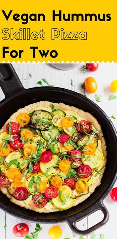 This hummus skillet pizza is the perfect size for two big eaters. The thick and chewy homemade gluten-free pizza crust is topped with veggie and hummus.