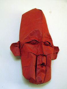 Eric Joisel Masks by foldingtype, via Flickr.  Wet-folding origami lends greater detail and subtlety to the final shapes.