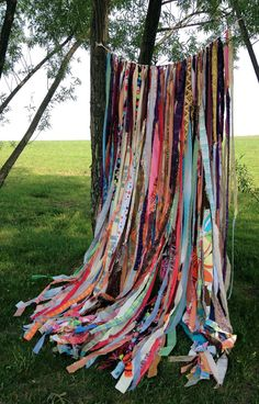 Garland for weddings, parties, backdrops or just to use on a patio of in a room. This garland is made from scrap fabrics. Come see HAIR live on stage at Sacramento Music Circus AUG 18-23, 2015 at the Wells Fargo Pavilion. TICKETS: http://www.californiamusicaltheatre.com/events/hair/