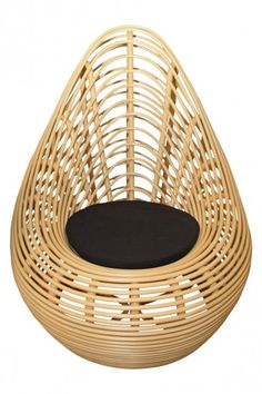 Find it at Viyet   Onyx Pure Rattan Chair   Along with rattan, the piece is constructed with water hyacinth, a plant indigenous to the Amazon. Its modern shape lends a distinctive flair, while a black upholstered seat cushion provides comfort.