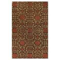Hand-tufted wool rug with floral motif.  Product: RugConstruction Material: 100% WoolColor: Chocolate...