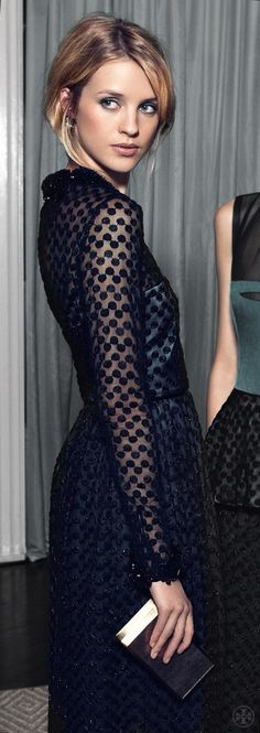 Fantastic look. Black lace structured femininity with a manly feel.  Love this a whole lot.
