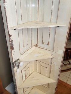 cool corner shelf made out of a door...what a great idea! (kitchen corner) love it! - could use old shutters also!