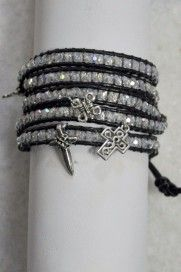Wrapping four times around your wrist, this black leather bracelet with clear translucent beads and cross charms sparkles with light. Like God's prophets, may your eyes be opened to the revelation of Jesus as the light of the world speaking only the Word of truth.