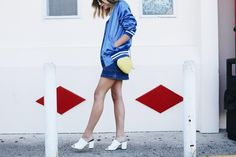 Style a bomber with a denim miniskirt and mules. Set yourself up for street style success with our editors' tips on how to style a bomber jacket.