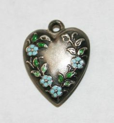 Sterling silver and enamel flowers heart charm.