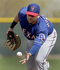Texas Rangers first baseman Mitch Moreland catches a ball during an intrasquad game at baseball spring training, Wednesday, Feb. 20, 2013, in Surprise, Ariz. (AP Photo/Charlie Riedel)