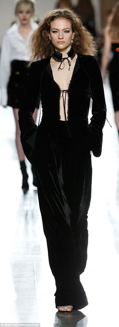 The final outfit of the experiment Emily, pictured left, tried was influenced by a head-turning velvet tuxedo onesie as seen at Topshop Unique, right