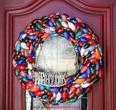 Transform burnt-out bulbs into a front door wreath! If bulbs are black and burnt, give them a coat of colorful paint so they fit in with the rest of the collection.