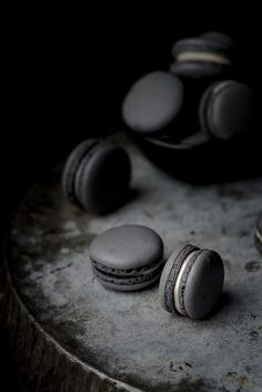 black macaron with white chocolate & black cherry