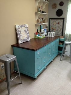Rolling DIY craft table from old file cabinets... well the top is wood!
