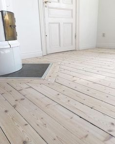 Soapstone in the hardwood for tile stove. Decor, Wooden Flooring, Beach House Decor, White Washed Floors, Home Decor, Welcome To My House, Flooring, Flooring Inspiration, Pastel Decor