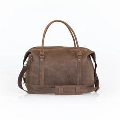 The Hold-All Traveller with its simplistic design features and smooth edges is handmade in our Stellenbosch studio from genuine South African leather. Pocket Light, Brown Canvas, Short Trip, Travel Luggage, Long Weekend, Hold On, Shoulder Strap, Trips, Leather