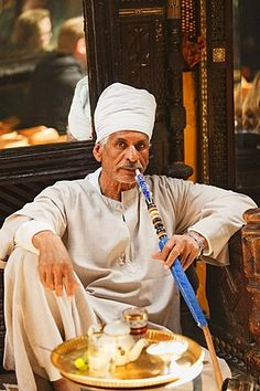 Drinking tea and smoking a waterpipe at the Cafe Fishawi in Khan el-Khalili bazaar, Cairo, Egypt