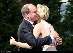 epa04842641 Prince Albert II of Monaco (L) and his wife, Princess Charlene of Monaco embrace during the celebrations to mark Prince Albert II's decade on the throne at the Royal Palace in Monaco, 11 July 2015.  EPA/VALERY HACHE / POOL Stock Photo