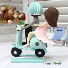 Items similar to Wedding Cake topper, Wedding Clay Couple on Vespa in blue and light pink theme, wedding clay miniature, clay doll, clay figurine on Etsy Polymer Clay Projects, Diy Clay, Vespa Wedding, Chicken Cake, Fondant Wedding Cakes, Fondant Decorations, Types Of Cakes, Pink Themes, Clay Figurine