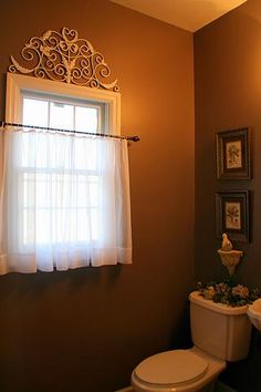 this with tension rods and a thick drape hanging over the top ... bathroom window privacy idea