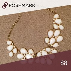 Bib Necklace White floral bib necklace.  Like new.  Great for dressing up a plain tee. Jewelry Necklaces