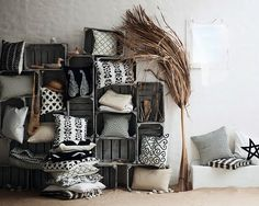 Pillows displayed in crates