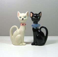 DESCRIPTION: This listing is for a cute pair of retro modern cat figurines. The female is white with a pink collar, and the male is black with a blue