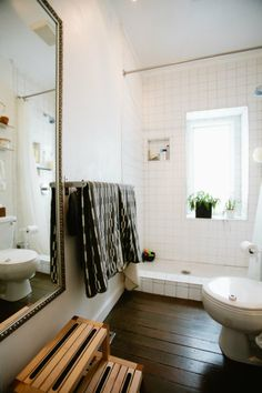 Emily & Jonathan's Urban Homestead House Tour | Apartment Therapy -- not digging what the shower is doing here...