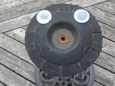 I'm not sure what this is, but it looks a lot happier ever since I glued these googly eyes to it.