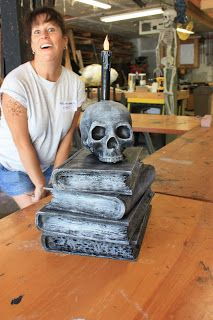 Do this with real books, Dollar Store skull and candle. They did it with sculpted foam.