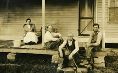 Laura and Almanzo, visiting  with  neighbors  on the back porch of their Rocky Ridge Farm home.