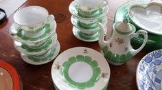 Vintage porcelain and china including Noritake green and white tea set with tea pot, 6 plates, cups, and saucers.