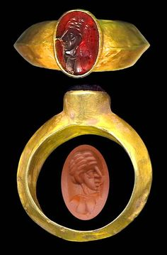 GREEK, c. 300-100 BC, gold ring with garnet intaglio, ring .