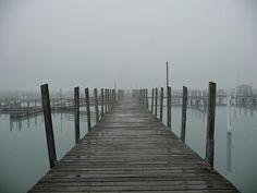 Foggy dock in the early fall morning in Lexington Harbor, Michigan.