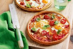 Here's a delicious twist on a family favourite - classic bacon and eggs with melted cheese and tomato on a delightful puff pastry base!