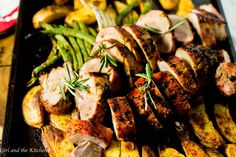 This incredibly flavorful Roasted Pork Tenderloin is absurdly simple to make and filled with mustardy and garlicky flavors! The best part is all the glorious juices from the pork act as a sauce for the veggies creating one uber flavorful one pan meal! This is one holiday meal that most certainly will impress everyone and tire no one! Plus learn the ultimate trick to getting a gorgeously browned tenderloin in only 30 minutes!