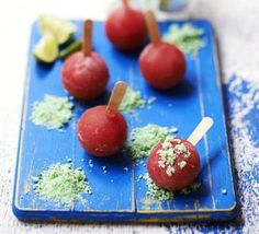 Pink melon lollies - Ice pops in the literal sense - these little frozen fruit balls are served with popping candy for extra pizzazz!