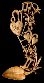 An innovative, beautifully designed and carved 'christening' lovespoon derived from 'the baby spoon'. Carved and designed by David Western.