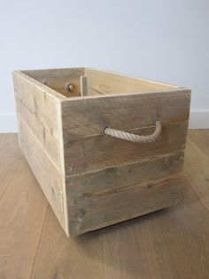 Recycled pine crate with top handles.
