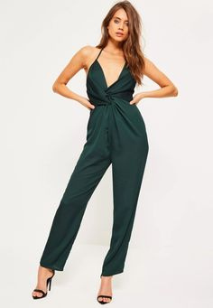 7e097bdc3e8 We  loving green this party season and this jumpsuit is at the top of our  lust have list - featuring an halterneck