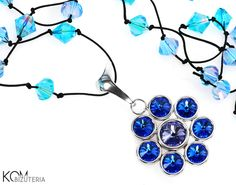Flower necklace - tanznaite and sapphire - Swarovski, silver, beads. Eye-catching, long necklace with flower like silver pendant with cold violet and intense blue Swarovski crystals on a black cord with blue and pink sparkling beads interwoven in it.