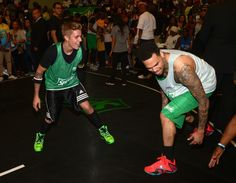 Baller alert. Justin Bieber takes on Chris Brown during the BET Experience celebrity basketball game on June 28 in Los Angeles