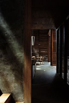 I am liking the vacation-y feel of this space. Photography by Helene Binet, Images from Michael Anastassiades.