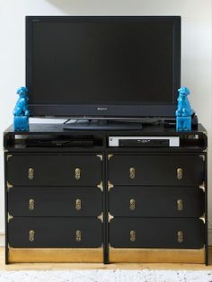 One Ikea Rast Chest, 16 Amazing DIY Hacks to Try! | iVillage.ca Asian Inspired   Push two cheap matching chests together to create an Asian-inspired, campaign-influenced TV stand. Dress it up with high gloss black paint, exotic pulls and corner brackets, to create a striking piece of furniture that looks high end.