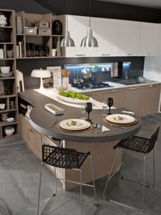 5/7 Stylish Kitchens For Modern Spaces I like the table because only one furniture but lot of function.